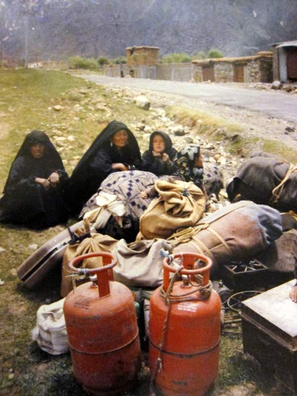 A war-displaced family along the road in Suroo Valley