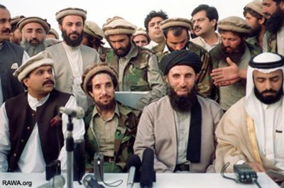 """""""May 25, 1992: Ahmad Shah Massoud (2nd from left) signing agreement with Gulbuddin Hekmatyar, the most wanted criminal in Afghanistan, in presence of their Pakistani and Arab masters."""" Photo credit: Rawa.org"""