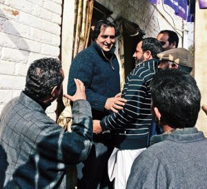 People's Conference leader Sajjad Lone meets supporters at his Handwara camp office before setting off on the campaign trail.